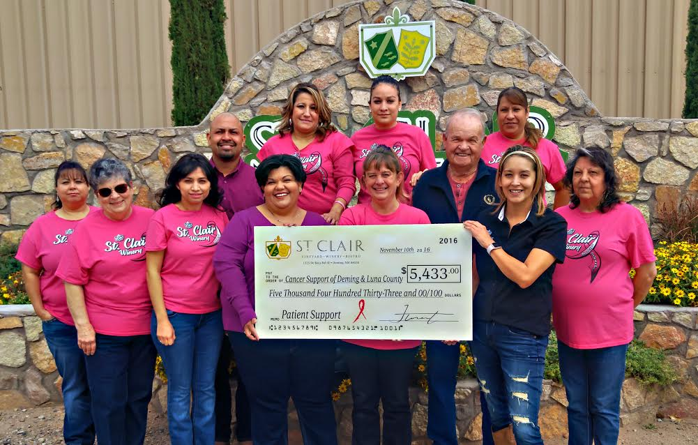 Photo courtesy: Daniel Gonzales/St. Clair Winery. Pictured are St. Clair Winery Staff led by Sales Manager Robert Duran, Tasting Room Manager Lora Robinson and Event Coordinator Naomi Morales presenting this year's donation to the Cancer Support of Deming & Luna County, Patient Advocate Joanna Costilla and Board Member Don Hill